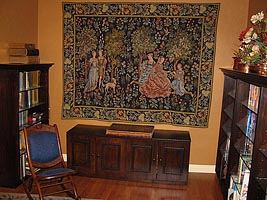 Medieval tapestry wall-hanging in a library