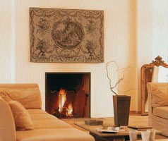 Elegant French tapestry above a fireplace