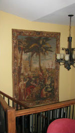 The Story of the Emperor of China tapestry hanging on a staircase