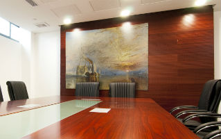 Turner Fighting Temeraire tapestry in a board room