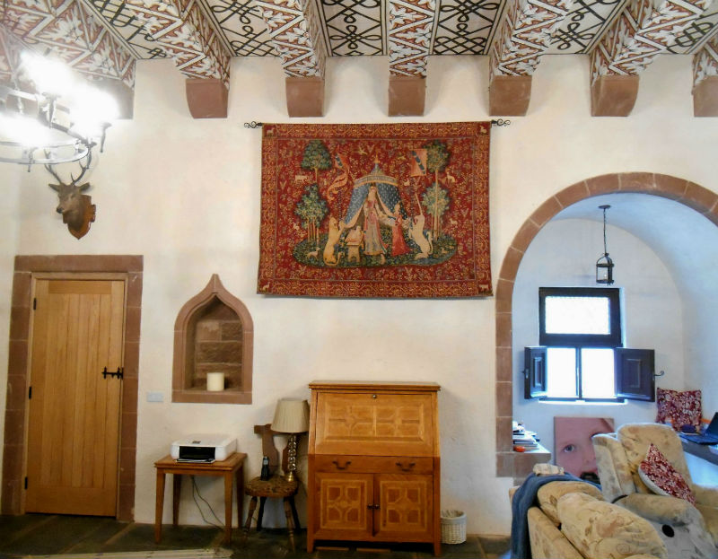 A Mon Seul Desir tapestry hanging in a castle
