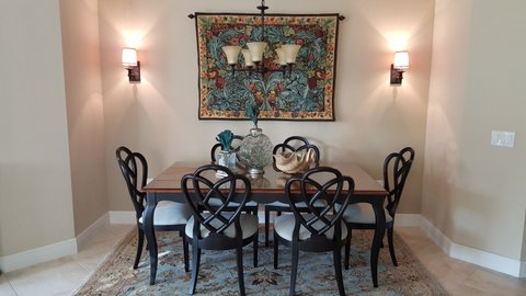 Acanthus and Vine tapestry in a dining room