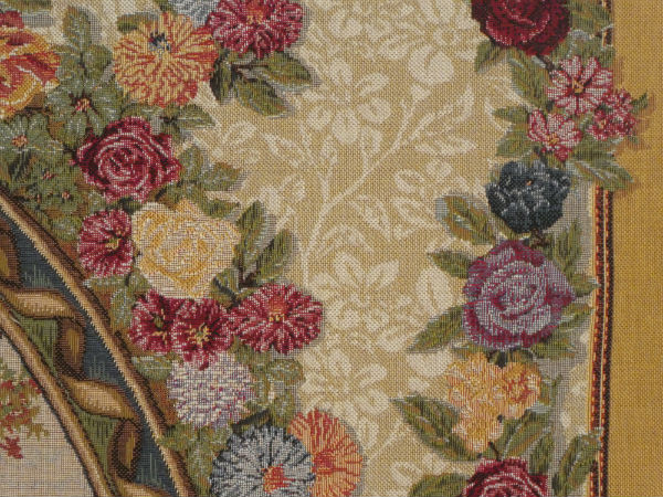 Close-up detail of The Swing by Fragonard tapestry