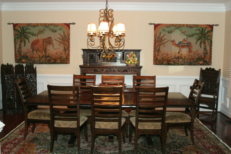 Elephant and camel tapestries in a dining room