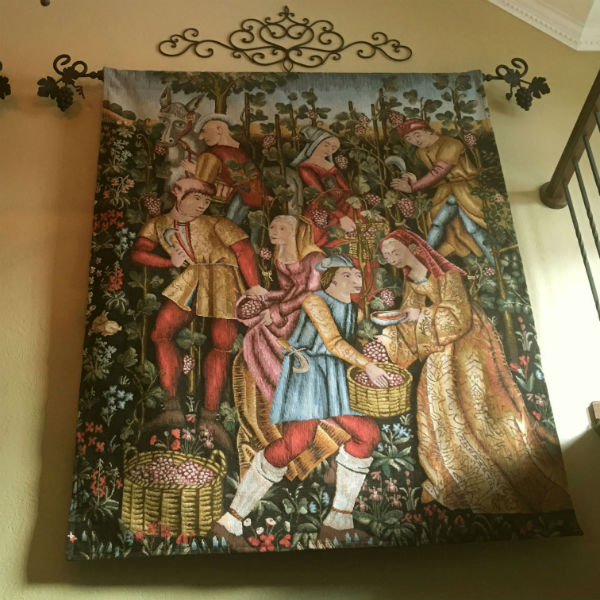 Grapes Harvest tapestry hanging in a home
