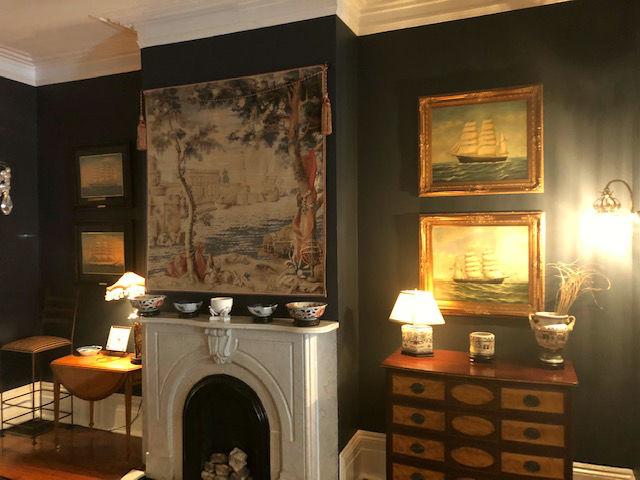 Port de Mer tapestry hangs in a home