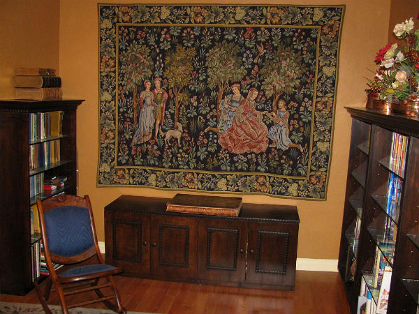 Scenes Galantes medieval tapestry wallhanging in a library