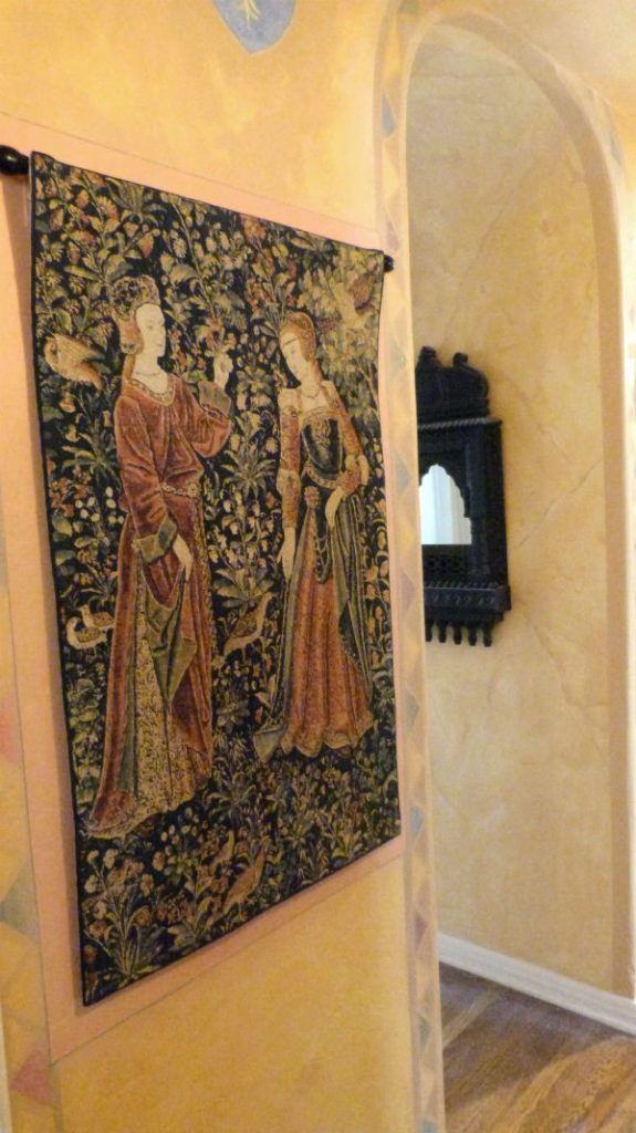 The Promenade tapestry with two figures in a medieval-styled room