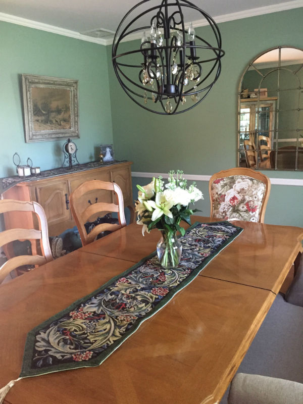 Longer green Morris table runner on a dining table