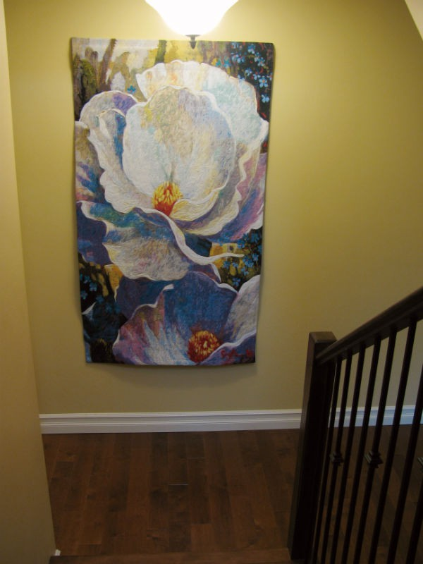 Morning Song tapestry at the foot of stairs