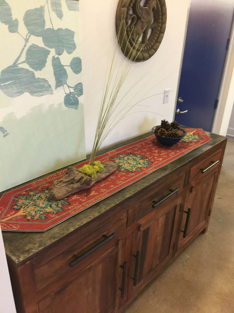 Orange Tree table runner on a chest