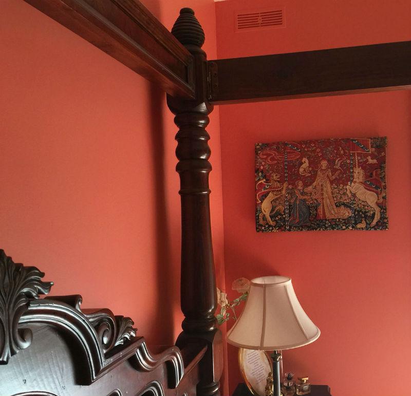 Taste tapestry hanging in a bedroom