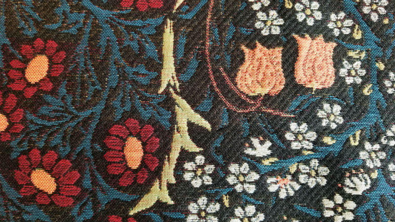 Detail of Blackthorn throw by William Morris